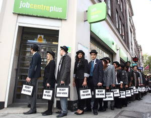 UK young unemployed congregate at job centre, London dressed in identical 'ready for work' suits to walk to Westminster to raise awareness of the million young people out of work in the UK