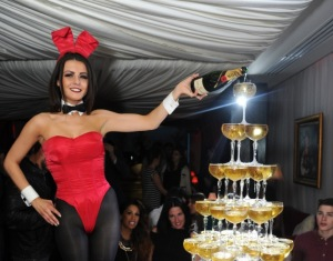Guests enjoy a Moet champagne tower at the launch of cabaret at Baroque at Playboy Club London (3)